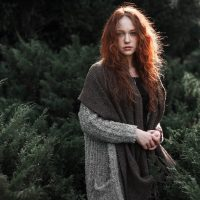 Beautiful Young Redhead Woman in the Woods