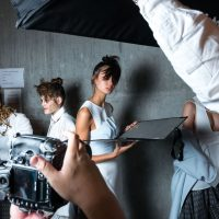 A Model Poses for Photographers Backstage at Mercedes-Benz Fashion Week
