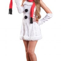 Beautiful smiling blonde woman wearing a short snowman dress and black heels for Christmas