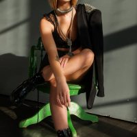 Beautiful green eyed blonde woman with a rocker look