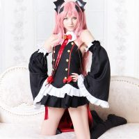 Beautiful cosplayer woman dressed as Krul Tepes wearing a short black skirt and red cape