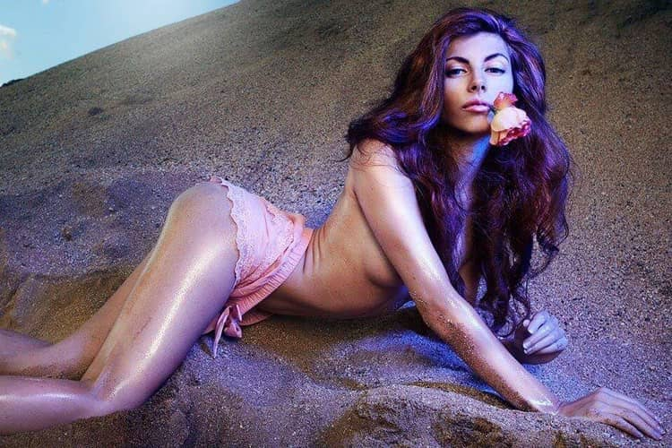 Beautiful czech model and gogo dancer slavena albastova lying in the sand with a rose in her mouth wearing pink panties showing underboob