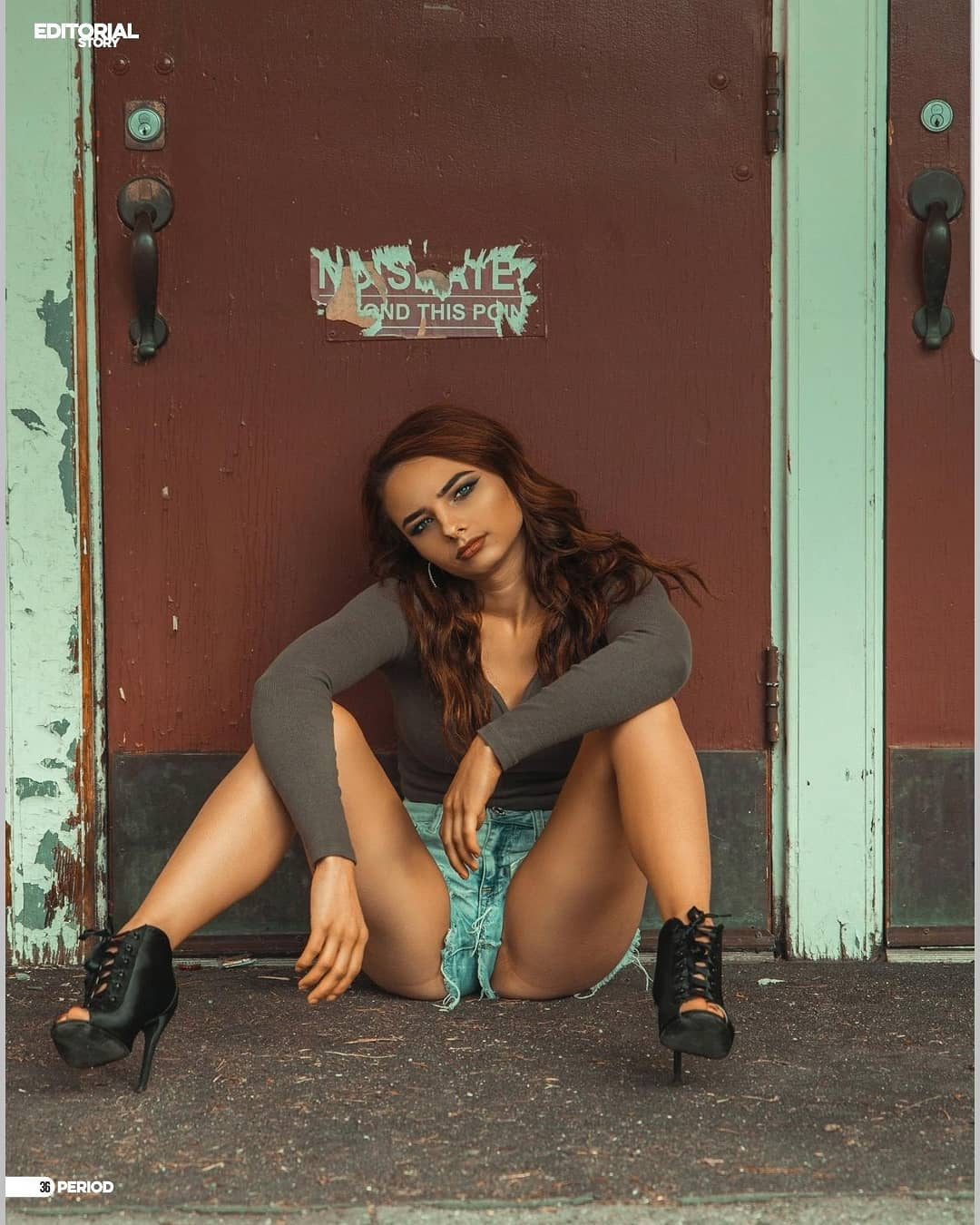 Beautiful young model Jenna Stewart wearing short ripped denim shorts and black high heels bootssitting on the ground with both legs wide open in a Kelvin Vinx Comendador photoshoot