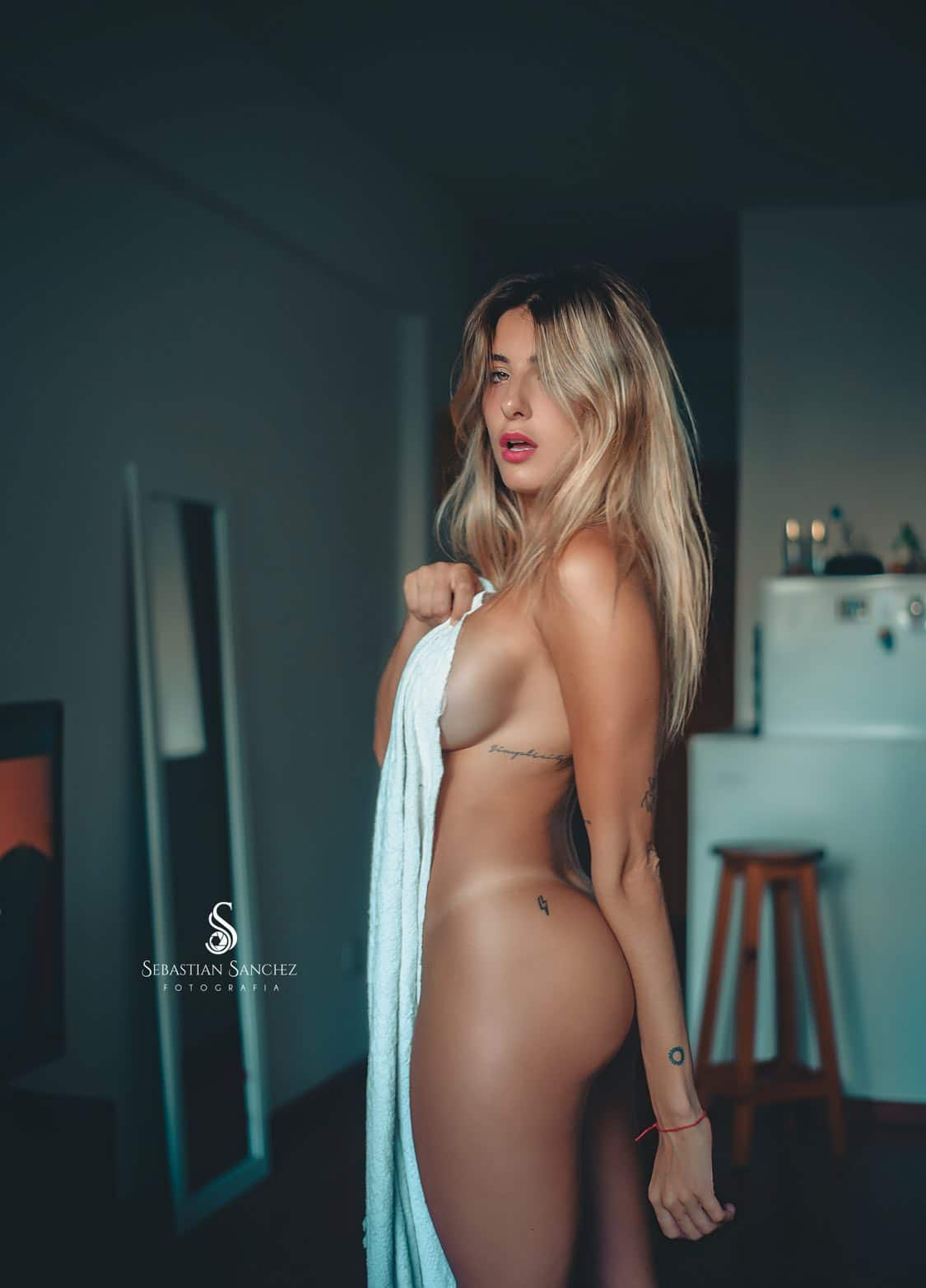 Beautiful nude blonde Argentine model Camila Sol Botti in a boudoir photoshoot showing her incredible fit body with her red lips open