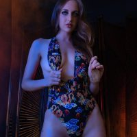 Beautiful model Miranda Fountain wearing a dragon and roses printed swimwear in a steamy boudoir ambiance photoshoot for Portrait&Boudoir Photography