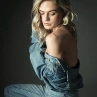 Bree Delamont, Beautiful model wearing a denim jacket showing her bare shoulder and bare back in a sexy pose
