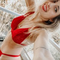 Beautiful Argentine model Camila Sol Botti having fun in a photo session wearing red lace lingerie