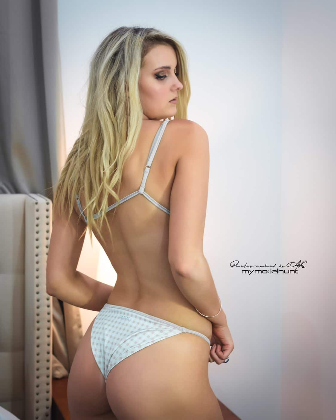 Beautiful Australian blonde model Maggie McGuire @iammaggiemcguire wearing a white bikini showing her bare back and ass cheeks