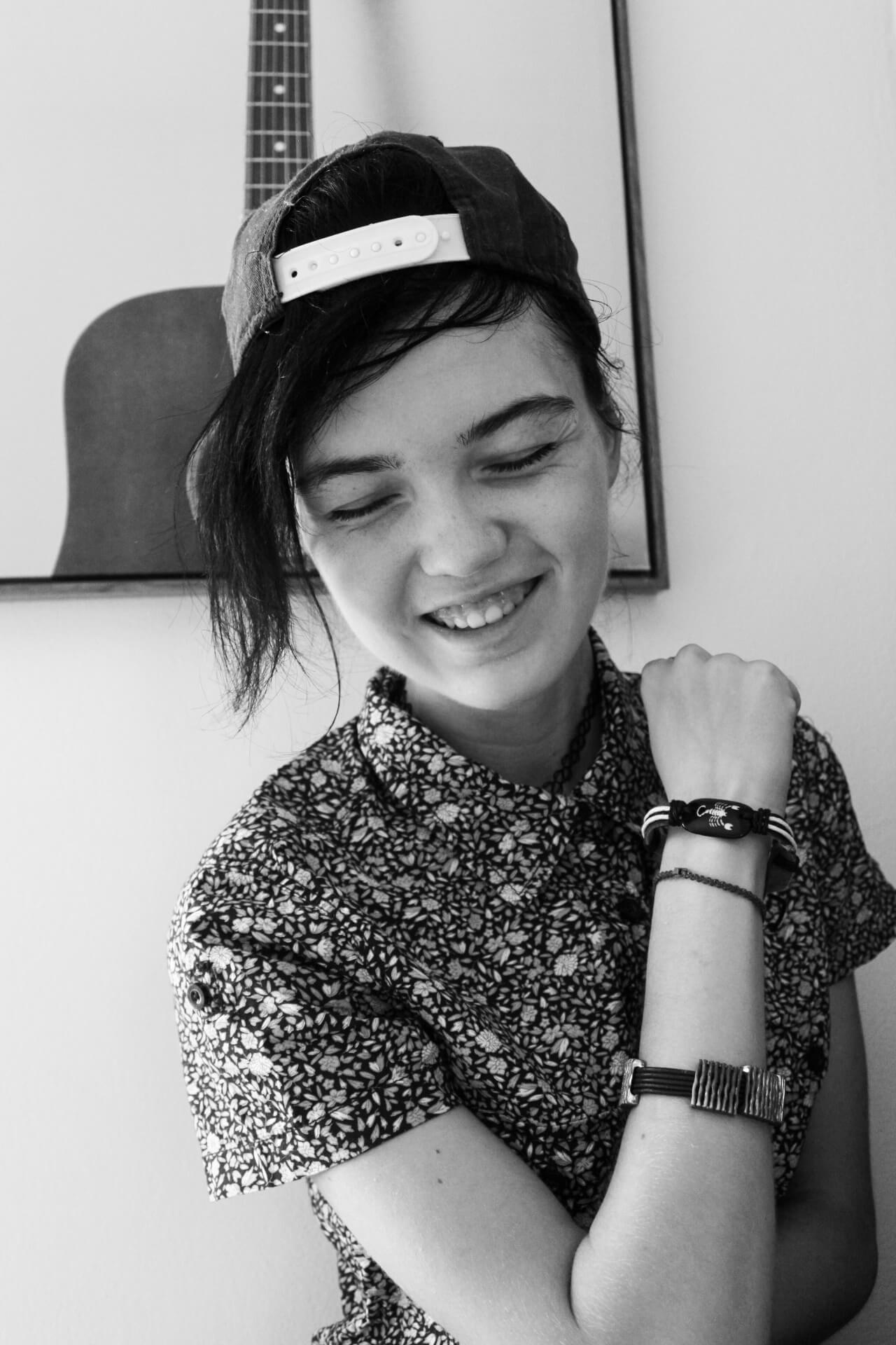 Beautiful black and white portrait of young photographer Beth Nighthowler @_nighthowler__ laughing