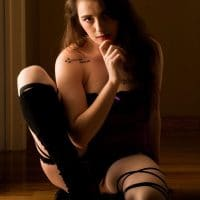 Beautiful brunette model Elizabeth wearing lingerie and high heels black knee high boots in a sexy photo session