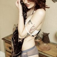 Beautiful inked model and mom Jessie Donovan @jessie_donovan_duo wearing lingerie for a sexy photoshoot