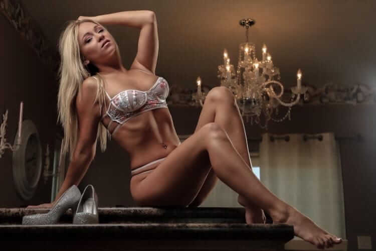 Beautiful blonde Dutch Playboy model Danielle Lynn @danilynn242424 wearing luxury lingerie sitting on a countertop showing her perfect toned body, her sexy long legs and bare feet