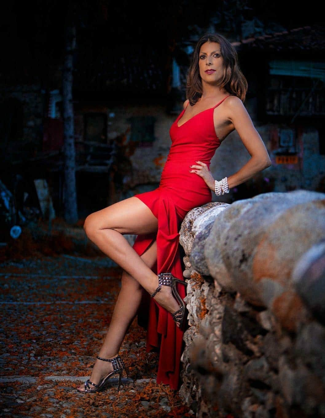 Beautiful Italian mature model and dancer Monica Fefe Soleil @fefe_soleil wearing a red open dress and high heels showing her long sexy bare legs