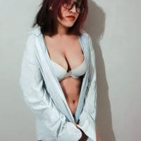 Beautiful Argentine model Carmen Bomrad wearing an opened shirt and white lingerie for a sexy photoshoot