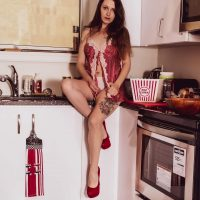 Beautiful Canadian model Elizabeth Model @teresaas_modelling sitting on the counter in a kitchen wearing a sexy red open night gown revealing her white panties with red high heels crossing her sexy bare legs