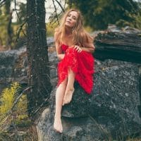 Beautiful blonde Canadian model _authorisation Darrian @darriankc sitting on a rock wearing a red dress bare foot