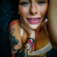 Beautiful tattooed blue eyed model doing in a series of sexy photos