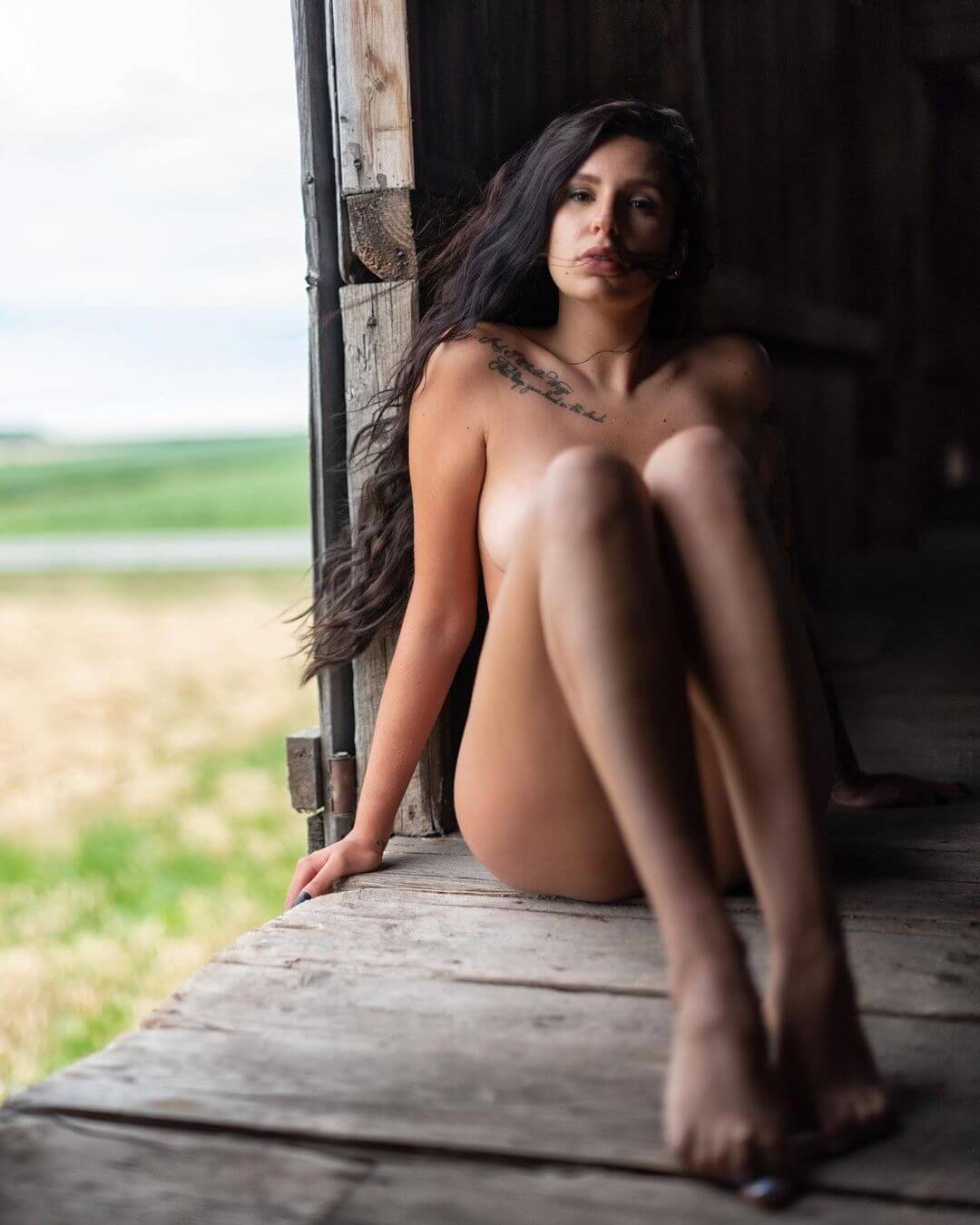Beautiful Canadian model Msk Black @m.s.k.black in the nude showing her fit body and sexy bare legs for an outdoor boudoir photo session on a freight train