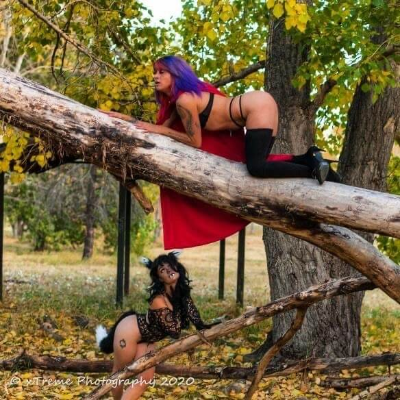 Sexy little riding hood @shyanmodeling perched on a tree branch wearing black stockings and lingerie and the hot and sexy big bad wolf @andi_markin looking at her showing her long sexy legs in a boudoir photo session by Jerry Stecko @boudoir4u