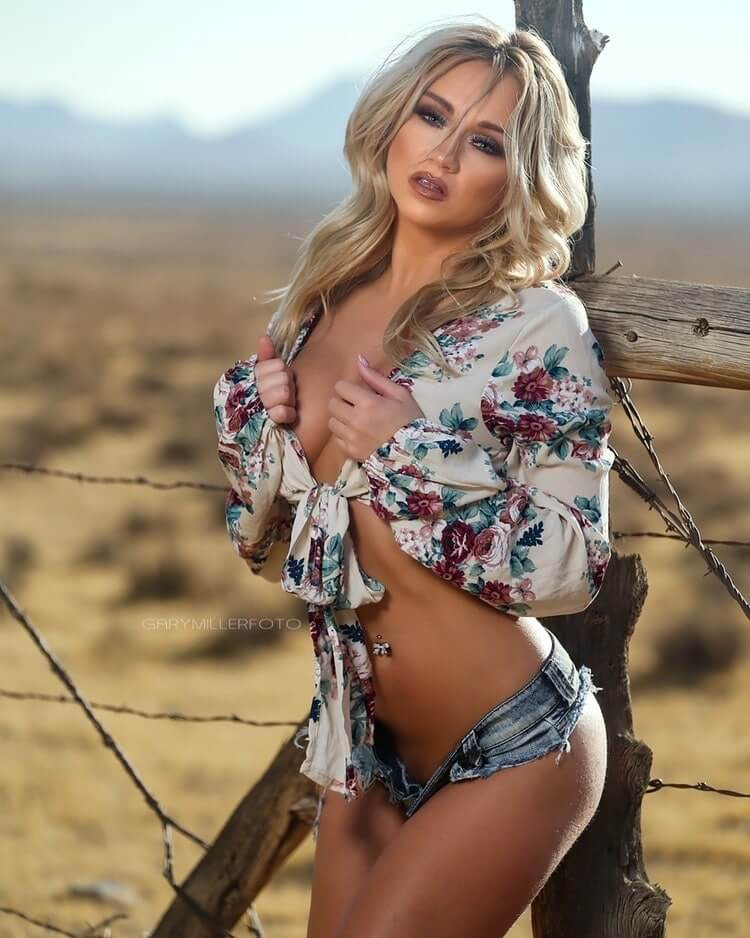 Beautiful blonde country girl Danielle Lynn @danilynn242424 wearing an open shirt and short denim shorts showing her hot cleavage for a sexy shoot