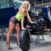 Beautiful Dutch model Willeke Bartels @willekebartels.fitmodel wearing short shorts and high heels showing off her long toned legs and sexy feet in a vintage auto repair shop