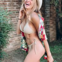 Beautiful Argentine model Camila Sol Botti laughing wearing a bikini and a cowboy hat