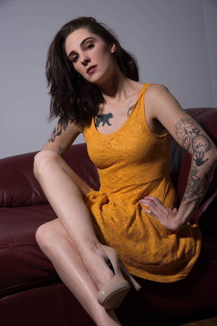 Beautiful Canadian tattooed model Ashley Stevens @ashley.s.modeling sitting with her sexy legs crossed
