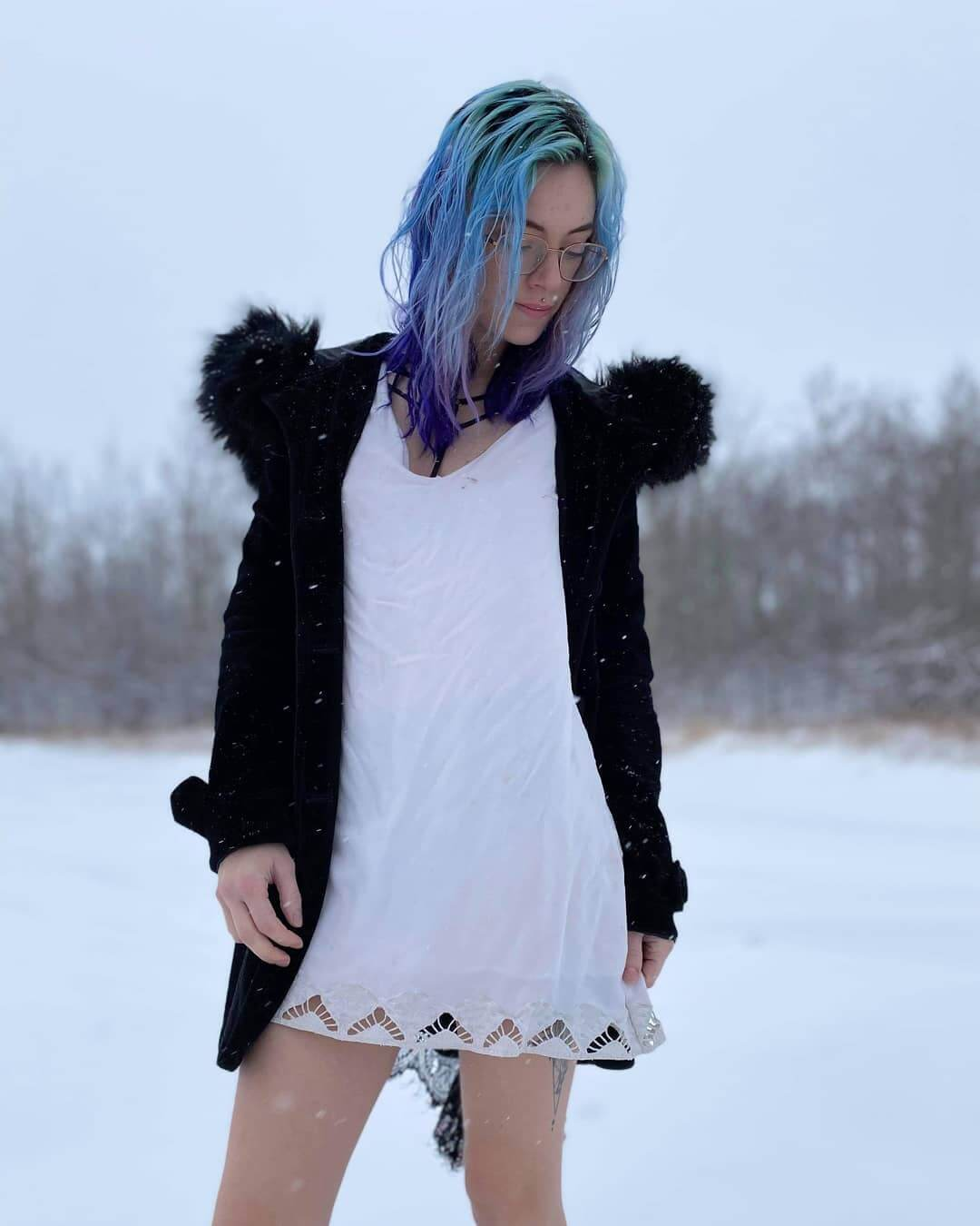 Beautiful Canadian goth snow queen Tora Reign @tora_reign wearing a see through baby doll in the winter