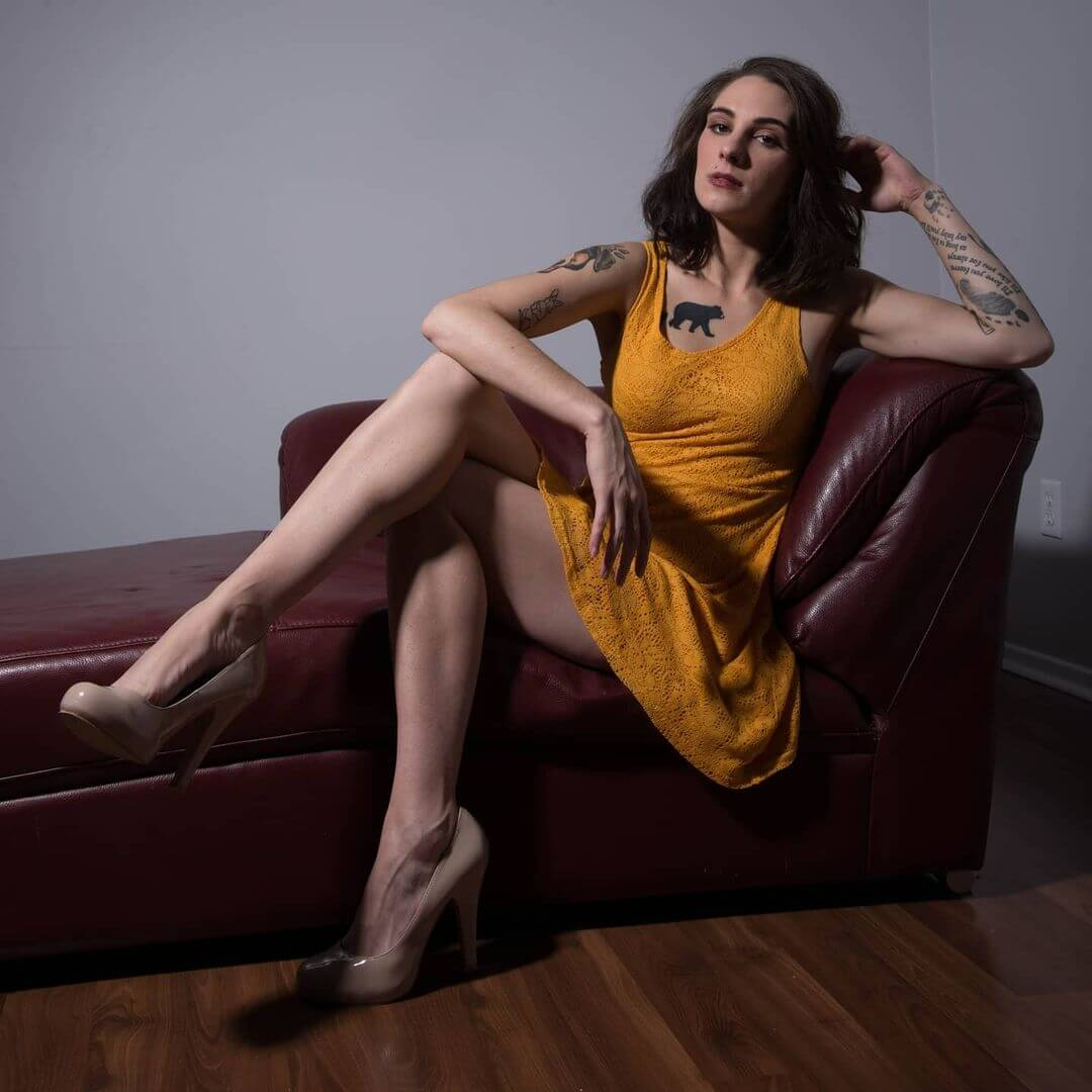 Beautiful Canadian model Ashley Stevens @ashley.s.modeling wearing a light orange dress and high heels putting her long sexy legs on display