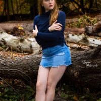 Beautiful Canadian red head model Sarah Samantha @sarah_samantha wearing a short denim skirt for a photo session in the woods showing her sexy bare legs
