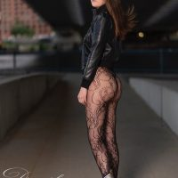 Beautiful American model Amber Nicole Nolan @amber.nicole_nolan wearing a leather jacket and black nylons pantyhose showing her sexy legs and hot booty