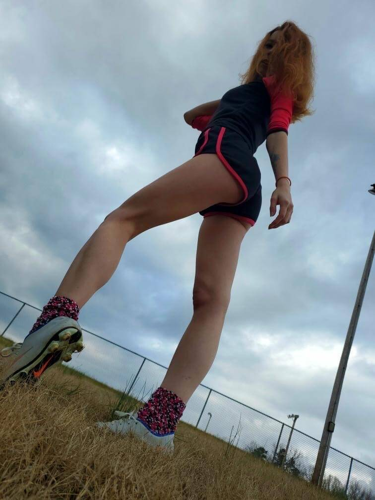 Beautiful young redhead American model Starfire @ starfirelove18 shot from below giving us a great view of her long legs and booty