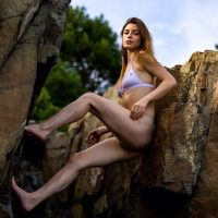Beautiful young American model Elannah @elannah_ wearing a bikini leaning on rocks showing her long sexy legs and some booty by True Image Photo @true_image_photo