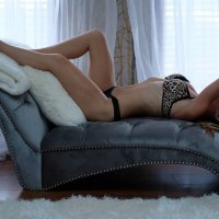 Canadian model BC Mama @bcmama7 lying bare feet on her back with her arm showing her long legs and fit body up wearing lingerie