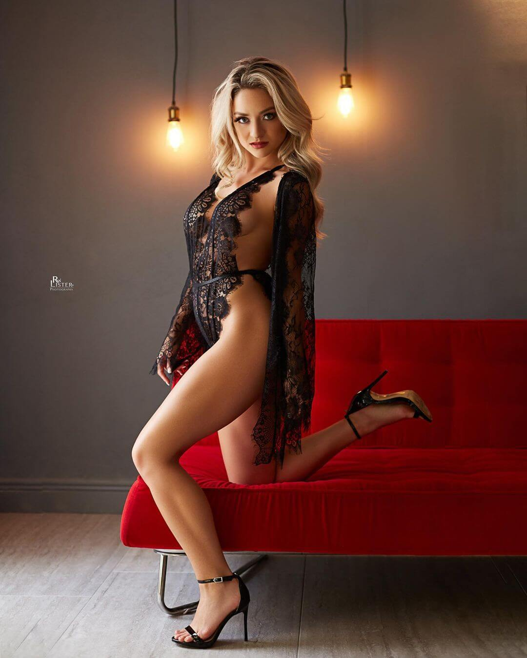 Beautiful blonde Penthouse Pet model Kenzie Mac @petkenzm standing showing her sexy legs and some side boobs wearing black lace lingerie and high heels in a sexy photo session by RW Llister photography @rwlisterphotography2