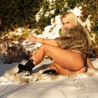 Beautiful Dutch snow queen Willeke Bartels in a sexy winter photo session