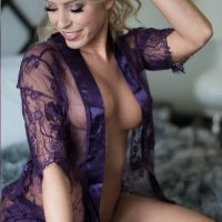 Beautiful Nicole Alexandra @blondebombshell_model wearing a purple lace robe showing her hot body and massive cleavage in a sexy boudoir photo session