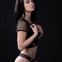 Beautiful and hot inked young Canadian model Samantha Neron @filledulac_xo wearing black fishnet top with black panties in a sexy photo shoot