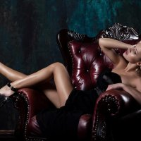 Beautiful Russian model wearing black and red lingerie in a sexy sensual photo session