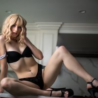 Model Brooke Carter @beachhblondee sitting on the kitchen counter with her long sexy legs wide open wearing black lingerie and high heel showing her hot fit body