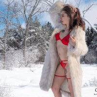 Canadian ink model Ashley Stevens @ashley.s.modeling showing her sexy fit body wearing red lingerie and a fur coat for a snow photo session