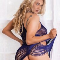 Hot Texas beauty wearing a purple transparent showing her sexy booty
