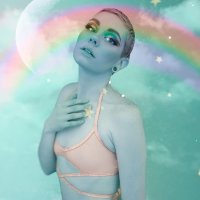 Beautiful California model and milf wearing rainbow clothing for a sensual and magical photo session