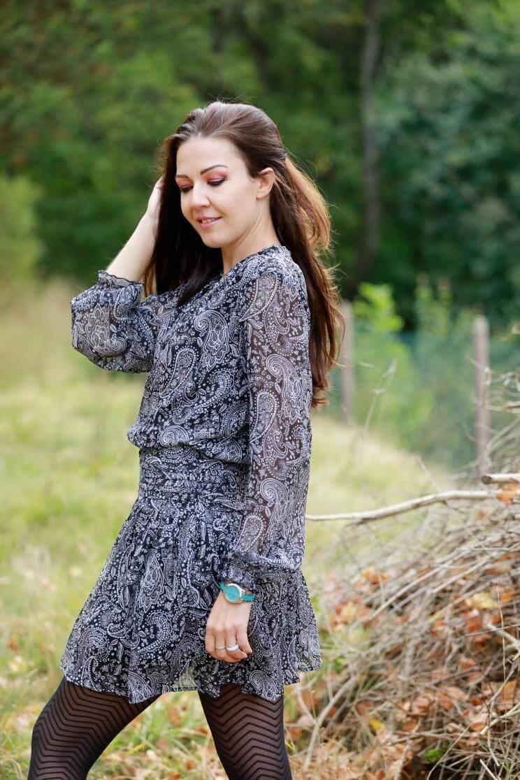 Beautiful slavic model wearing a short grey dress with black nylons on a autumn day