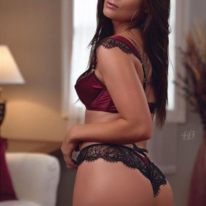 Beautiful brunette glamour model Zoe Wild @zoe_wild_xx wearing black and red lingerie looking over her shoulder showing her hot ass in a boudoir session
