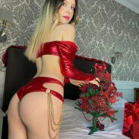 Beautiful blue eyed Italian model Laura @lauren_passion wearing red lingerie showing her hot booty in a sexy Christmas photo session