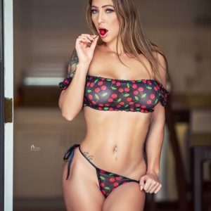 Beautiful Florida inked model Angela Tilley eating a cherry wearing a transparent cherry patterned bikini showing her hot body for a sexy photo session by RW Llister photography @rwlisterphotography2
